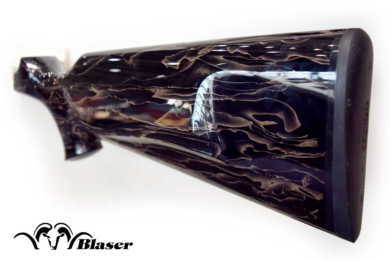 Blaser R8 gunstock in black Raffir Noble with bronze wave pattern.