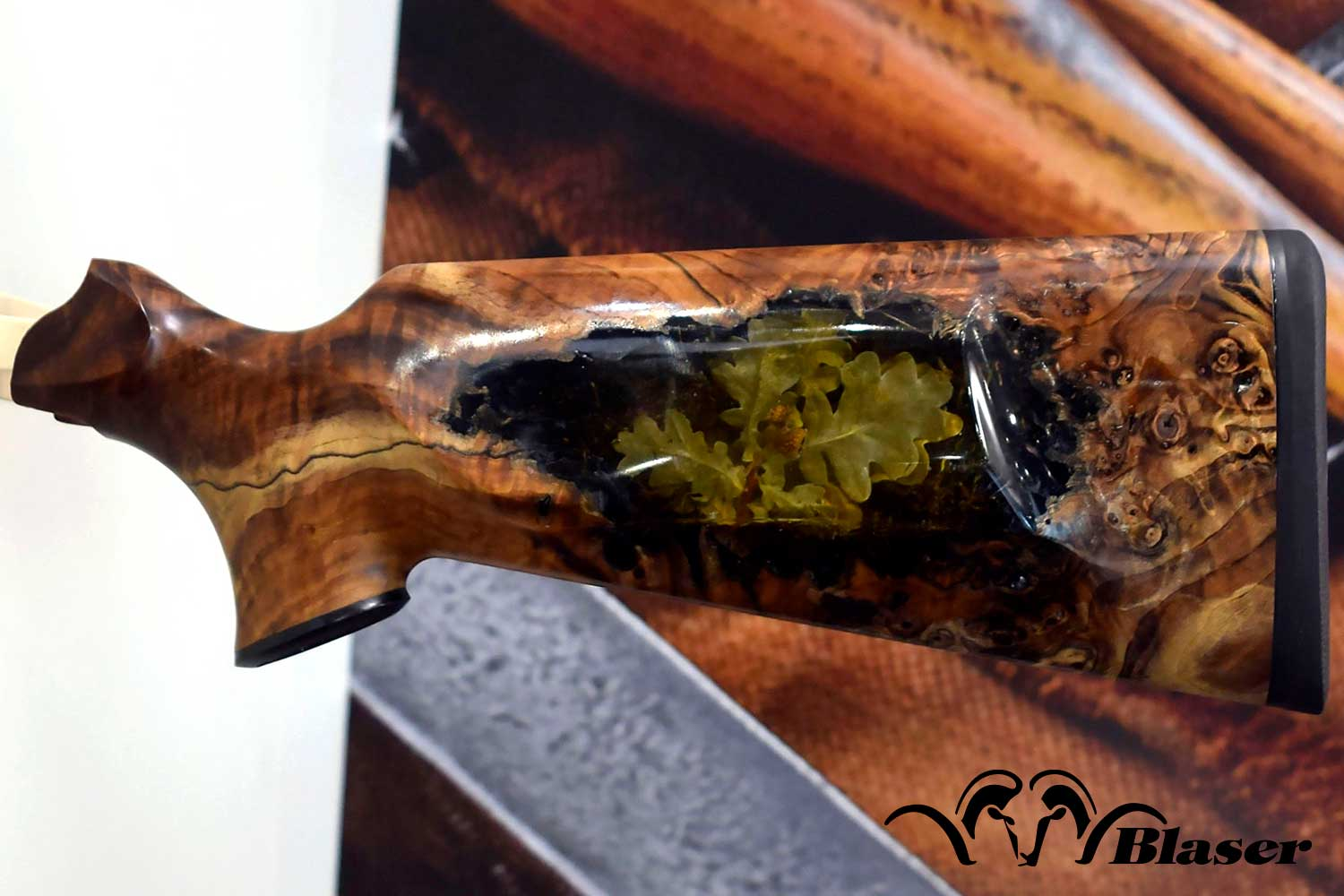 R8 Gunstock by Blaser Custom in stabilized poplar burl with oak leaves and acorns cast inside.