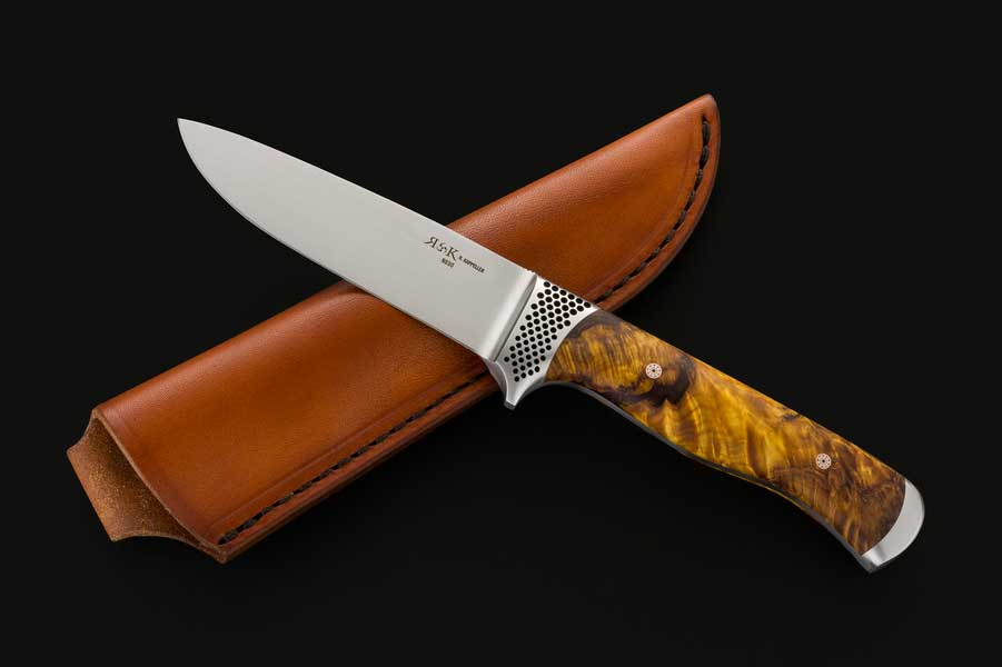 Hunting knife by Richard Kappeller with a yellow stabilized poplar handle.