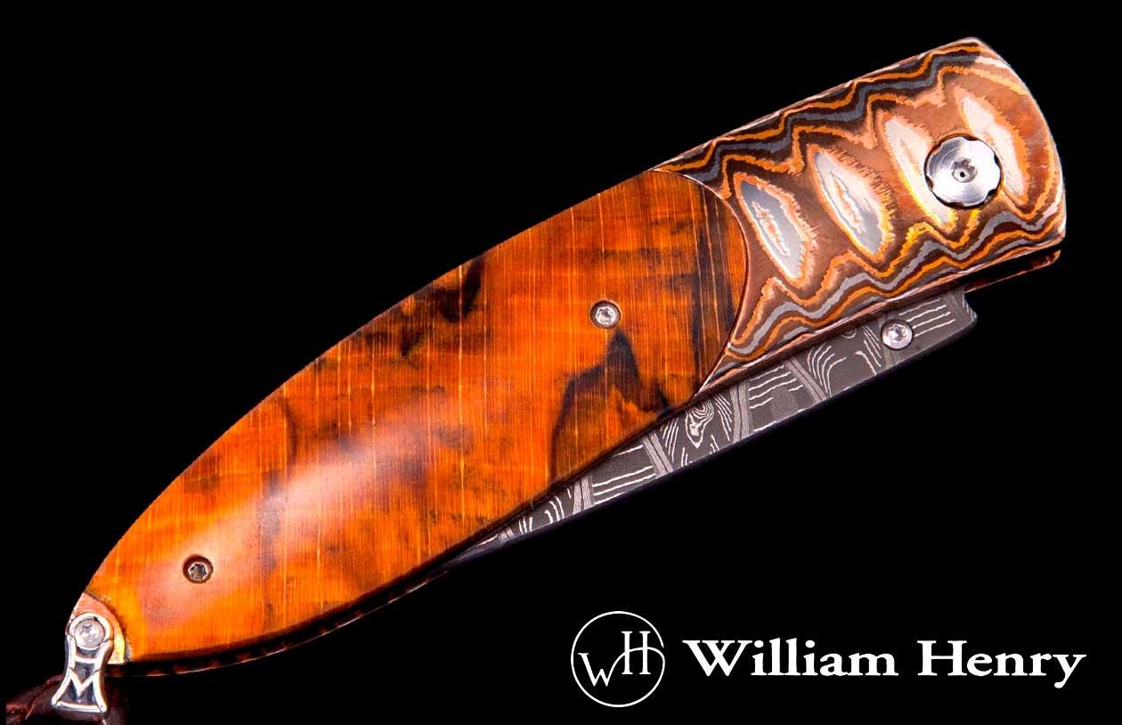 William Henry gentlemens folder with orange spalted beech handle inlays.